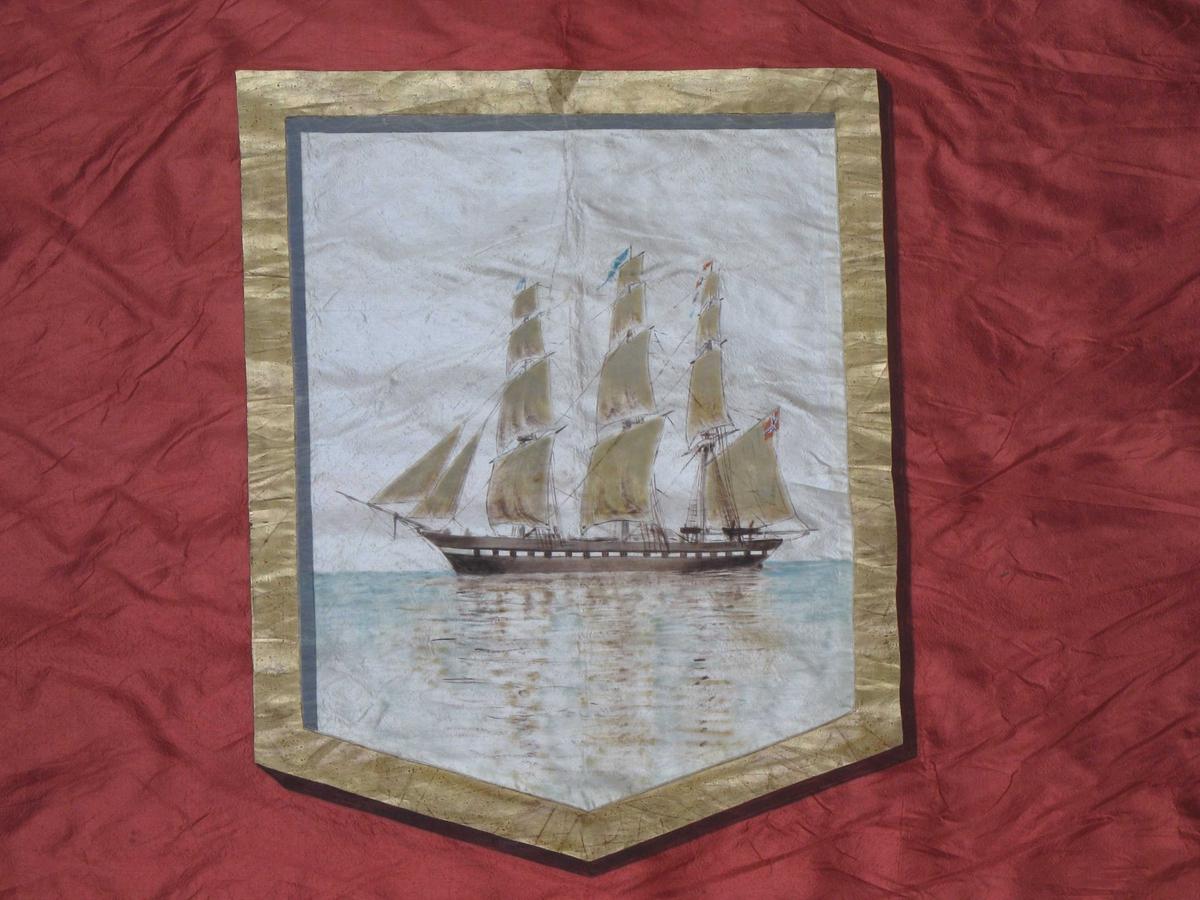 Arendal Turnforenings emblem, guirlander med eikeblader, bånd med tekst (motto).