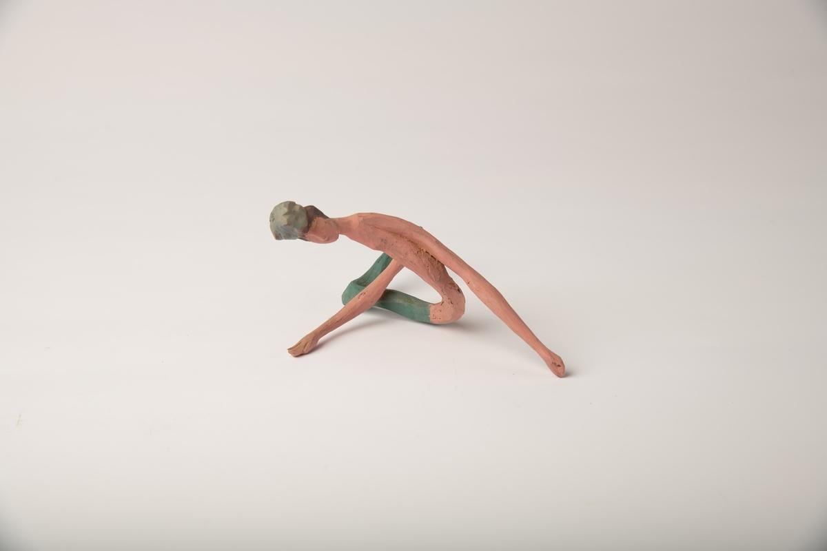 Ettbenet akrobat med grønn strømpe . begge armene er tynne og la