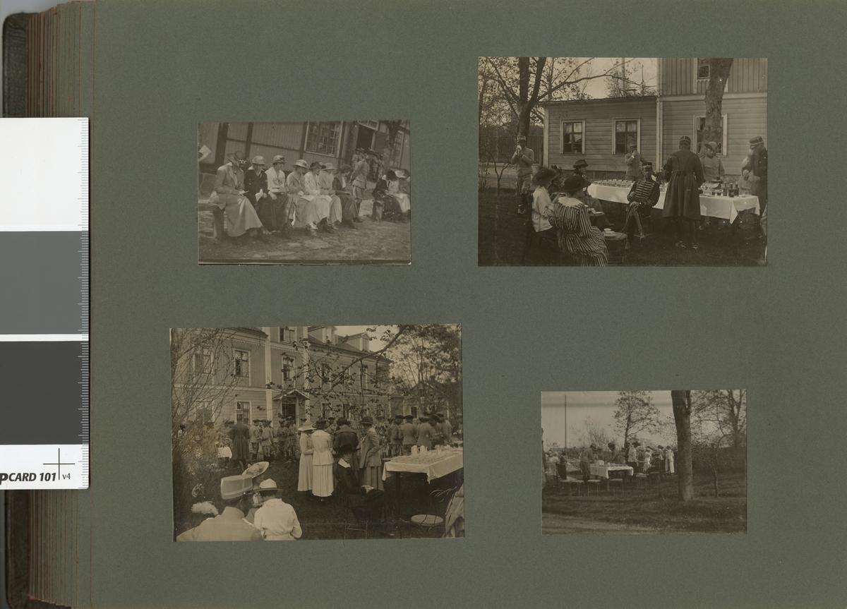 En sällskap med soldater och civila framför en byggnad.