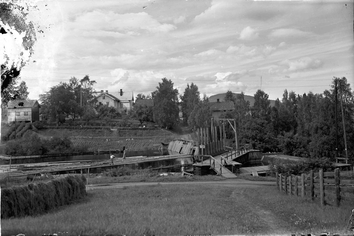 Eidsvoll Verk. Bilde av demning ved Eidsvollbygningen rett ovenfor Mago A