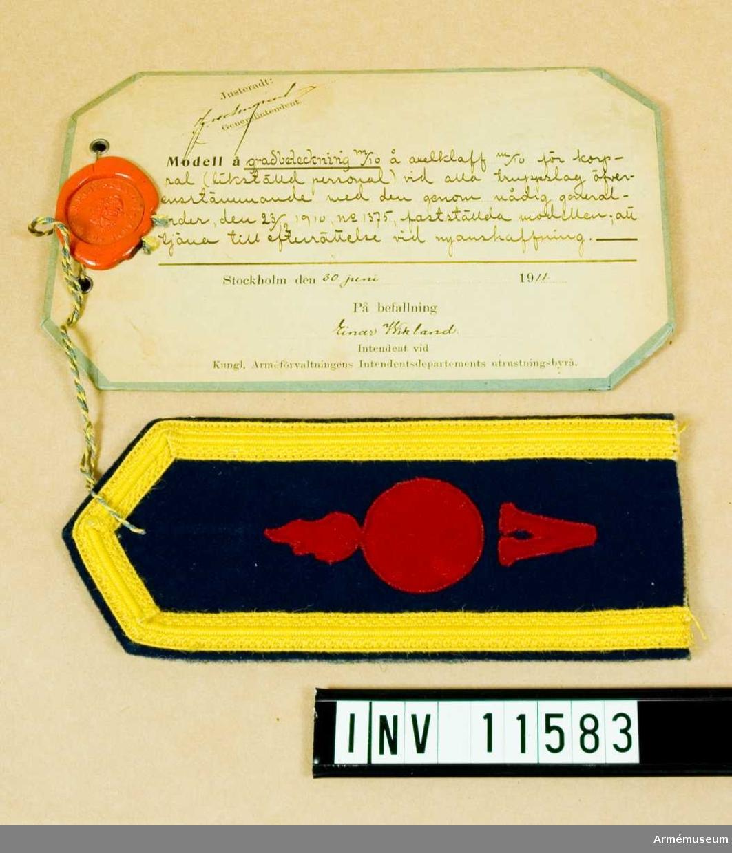 Grupp C I.  Gradbeteckning m/1910 å axelklaff m/1910 för korpral vid alla truppslag.