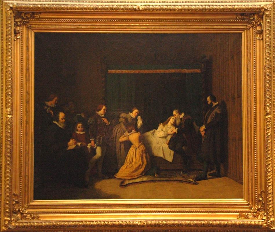 """Oljemålning på duk, """"Gustaf Vasa vid Margareta Leijonhuvuds dödsläger"""".  I en säng med gröna förhängen halvligger M.L. stödd av Gustaf Vasa. Denne har  svart dräkt och brun pälsjacka. Vid sidorna står och knäböjer anhöriga m.fl. T.v. sitter en prästman på en stol läsande bibeln. Bred förgylld ram."""