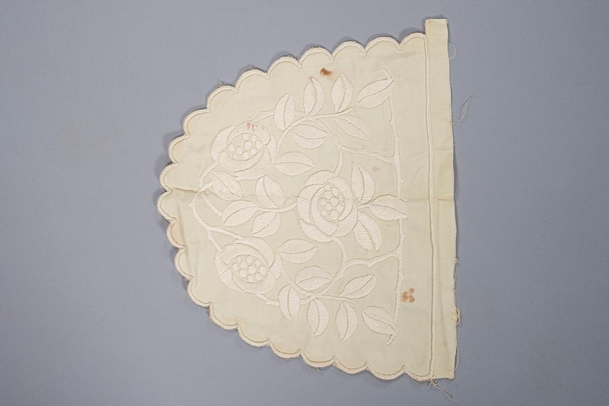 Tevarmer, 2 av 2 deler. Den er brodert med jugendinspirerert blomstermønster.