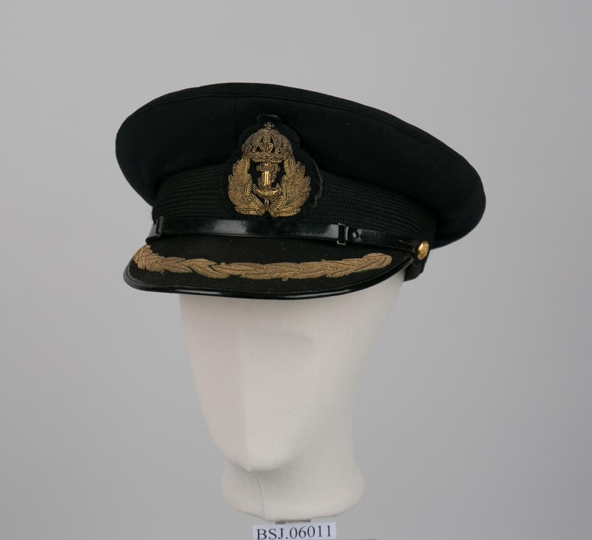 Sort uniformslue med skjerm og Nortraship merke.