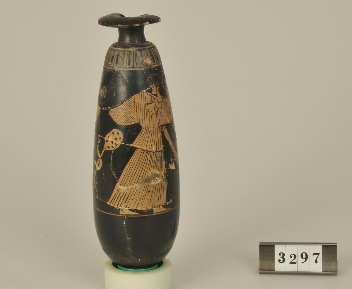 Rödfigurig flaska för olja och parfym. Har tillhört de Adelsköldska samlingarna.